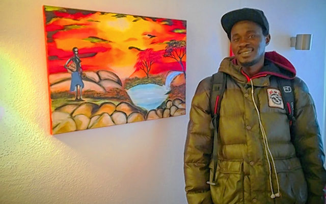Armand Diagne vor einem seiner Bilder.
